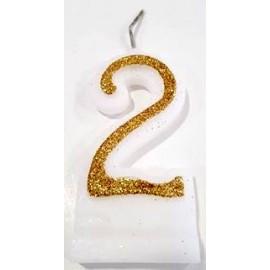 Vela com purpurina dourada nº2 com 9 cms