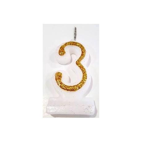 Vela com purpurina dourada nº3 com 9 cms